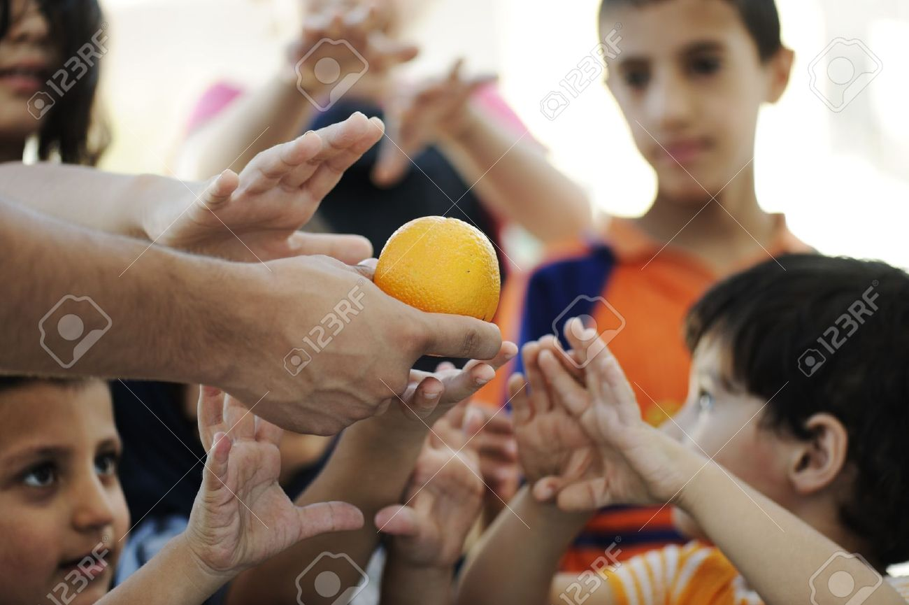 Hungry children in refugee camp, distribution of humanitarian food Stock Photo - 10680735