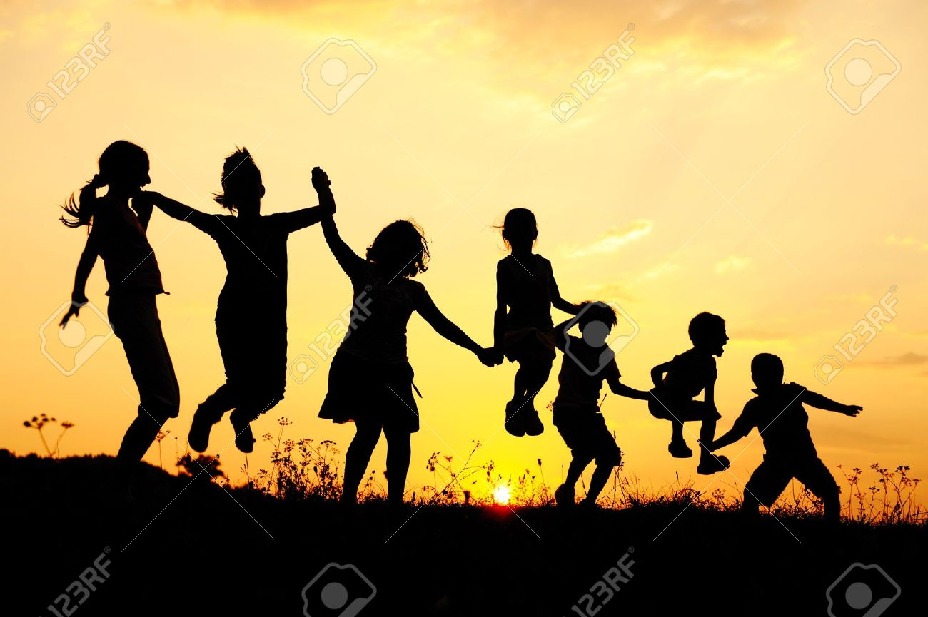 Silhouette, group of happy children playing on meadow, sunset, summertime Stock Photo - 10873922