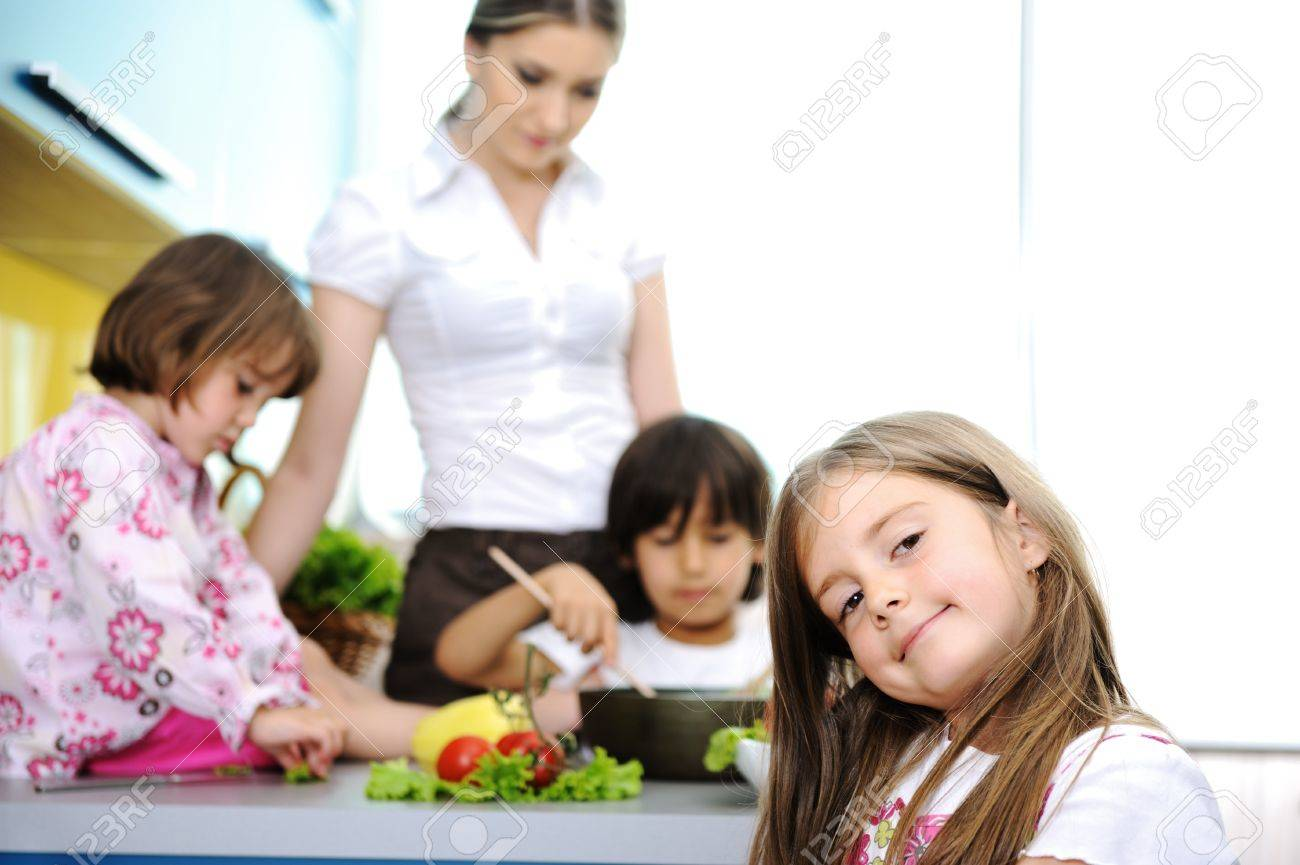Happy family in kitchen - Happy Family In The Kitchen Mother And Children Cooking Together Stock Photo 11176685