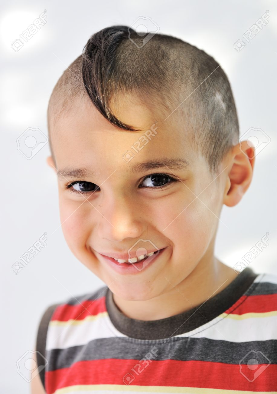 Cute Little Boy With Funny Hair And Cheerful Grimace Stock Photo