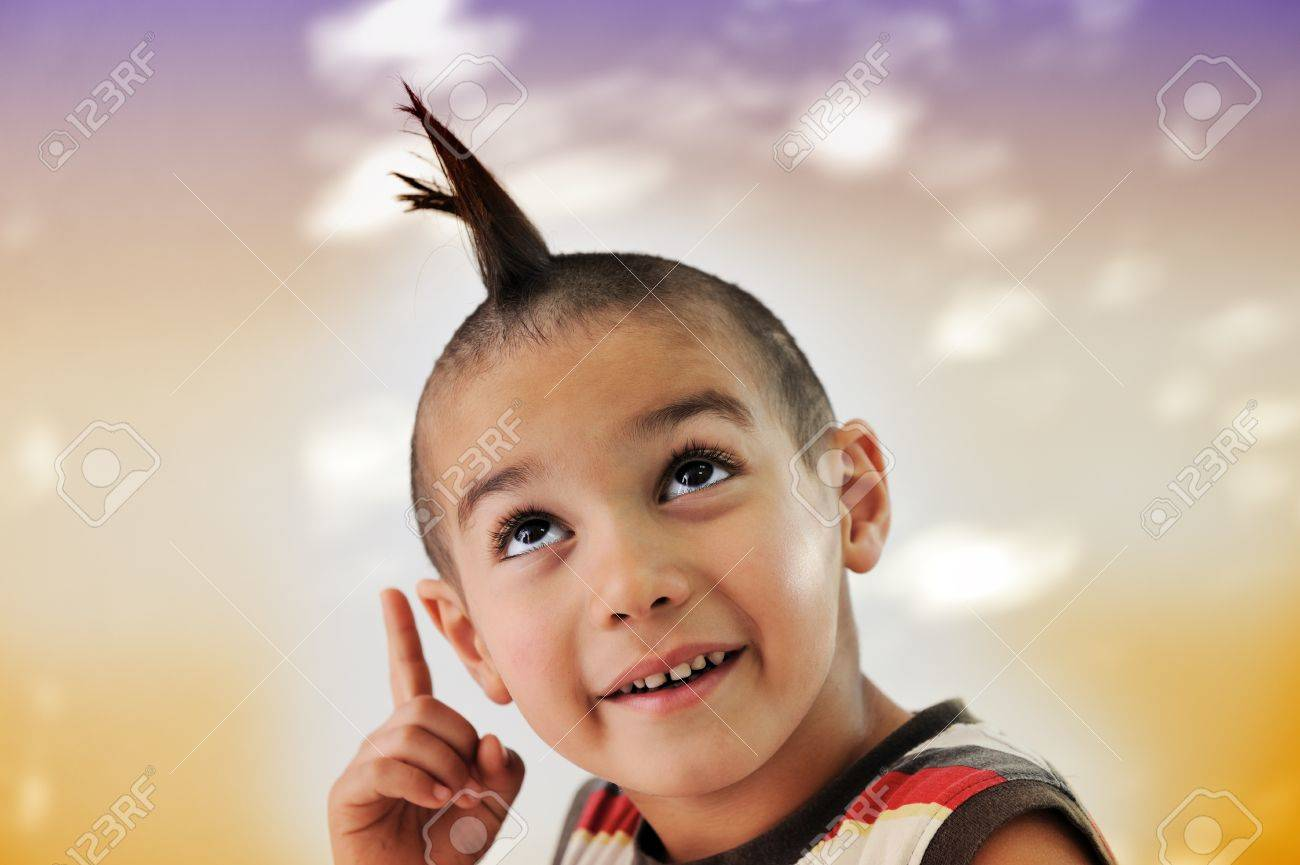 Cute little boy with funny hair and grimace Stock Photo - 11176784