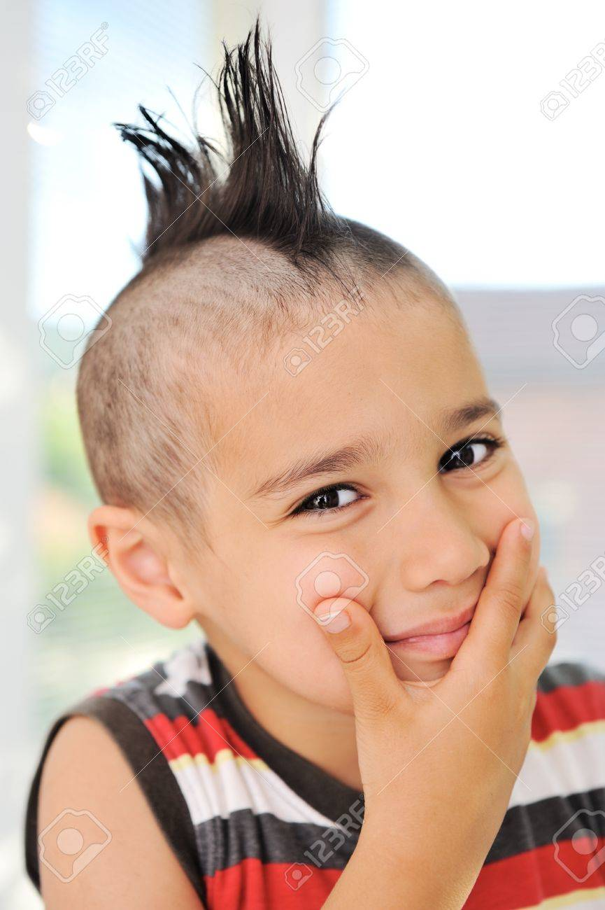 Cute Little Boy With Funny Hair And Grimace Stock Photo Picture And