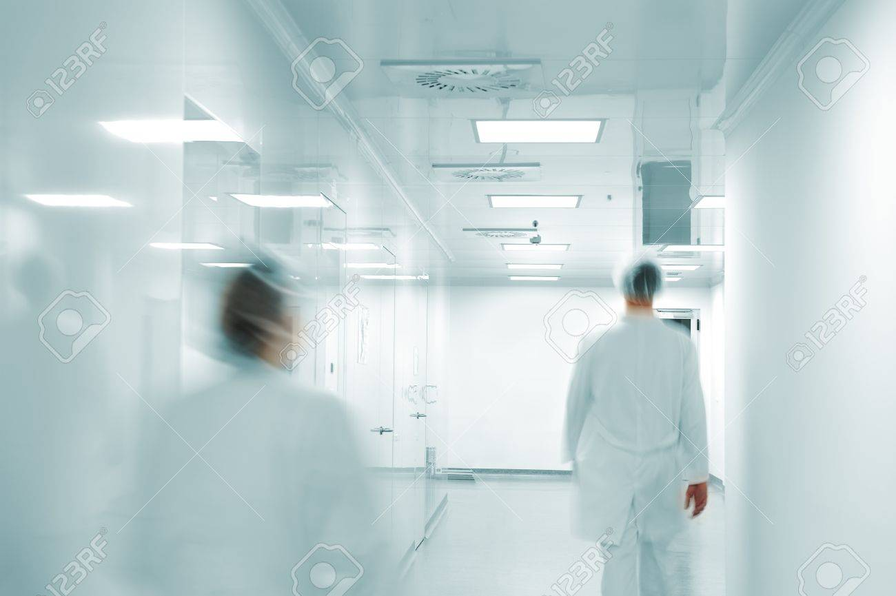 Working people with white uniforms walking in modern  factory environment Stock Photo - 11953003