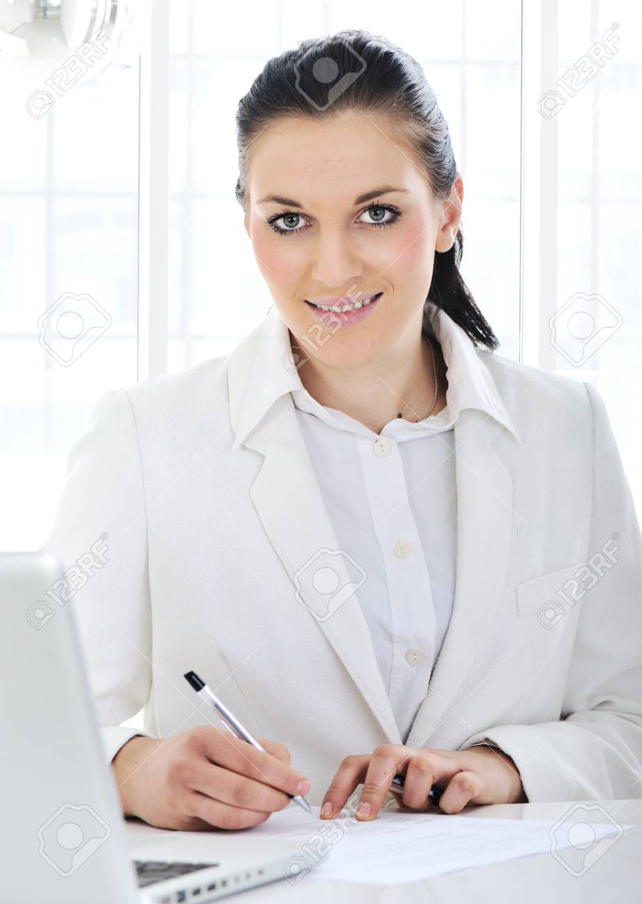 Business woman signing documents at office Stock Photo - 12627435