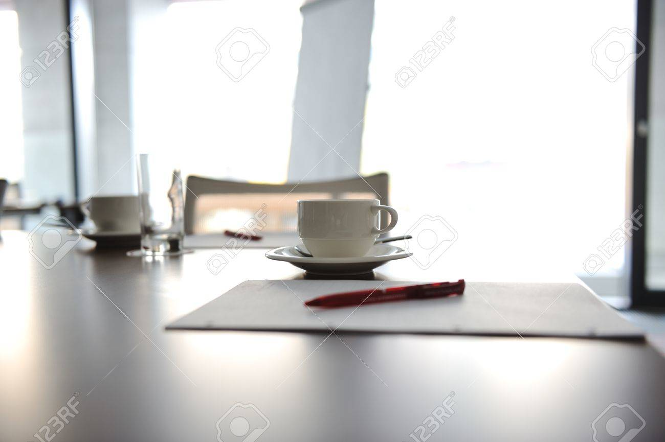 cup of coffee on table in the conference room stock photo, picture