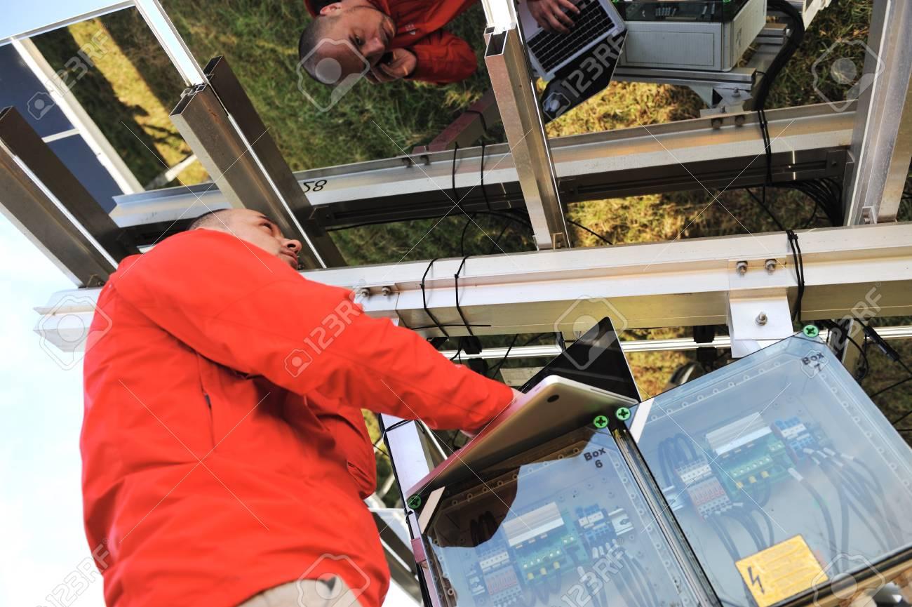 Engineer working with laptop repairing  solar panels Stock Photo - 12627148