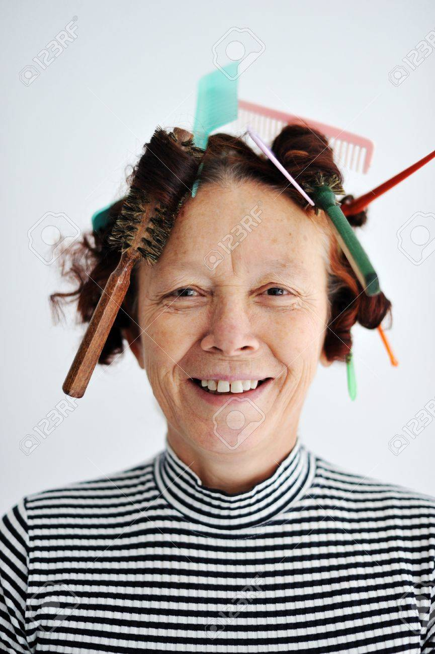 Senior female multitasking with many combs in hair Stock Photo - 13381814