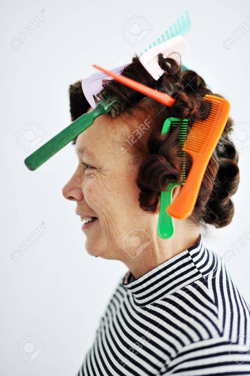 Senior woman with many combs on hair Stock Photo - 13381884