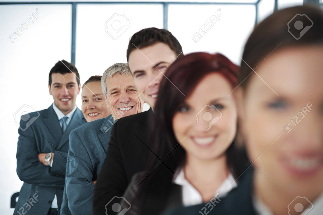 Six cheerful business people standing in a row with their arms folded Stock Photo - 13381996