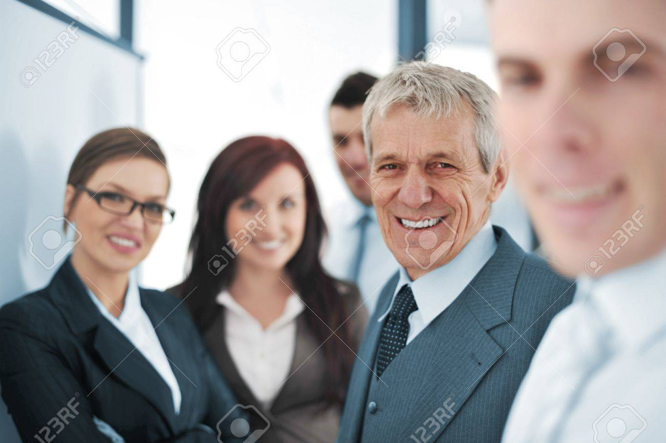 Small business team in the office in front of a whiteboard Stock Photo - 13381972