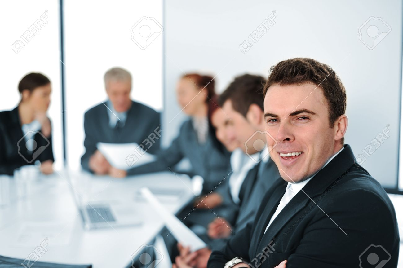 Team of young professionals working on new business project at a meeting Stock Photo - 13381975