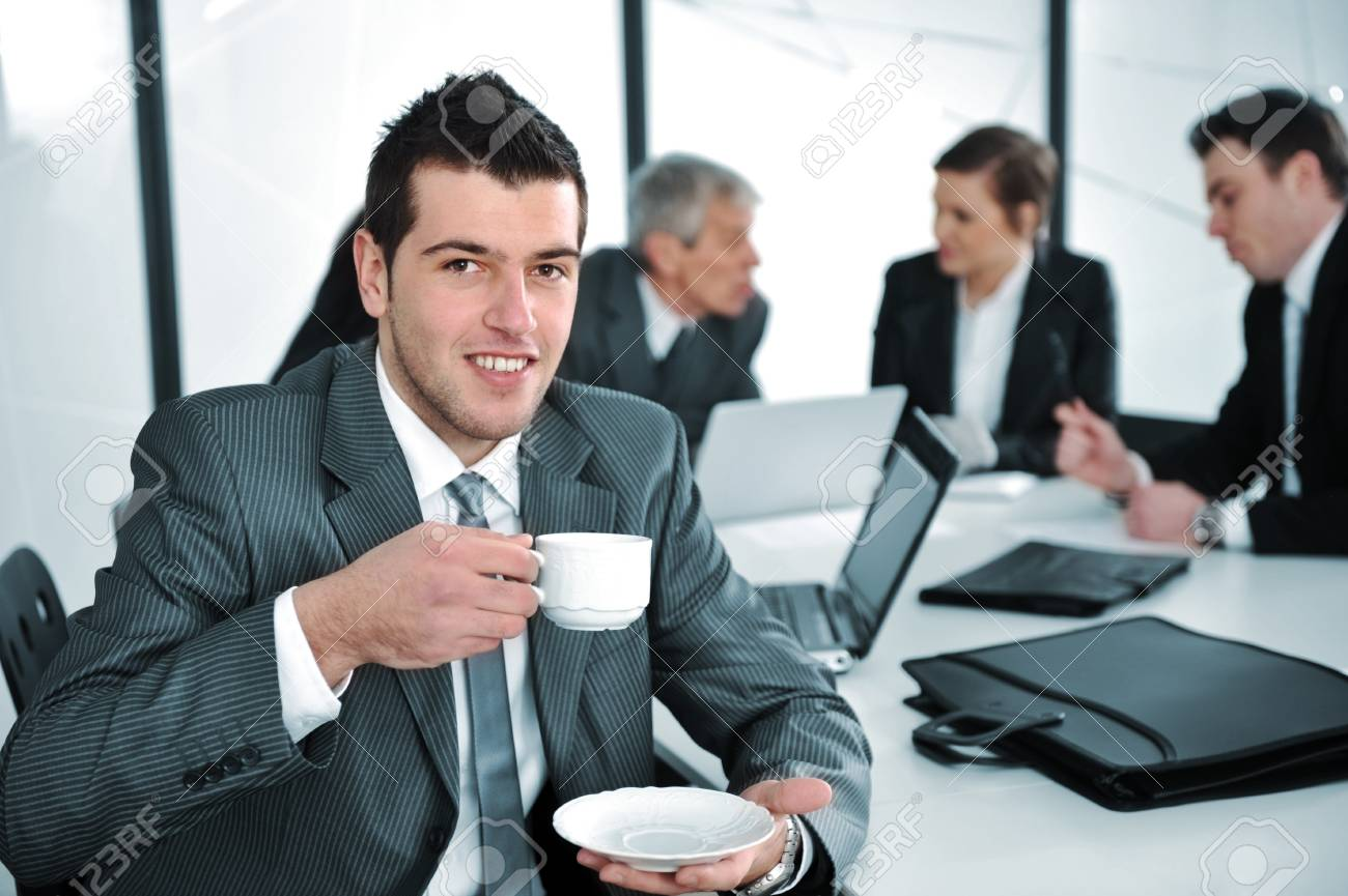 Businessman in business ambience drinking cofee Stock Photo - 13667754