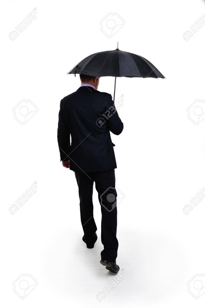 business man in elegant modern suit holding an umbrella standing