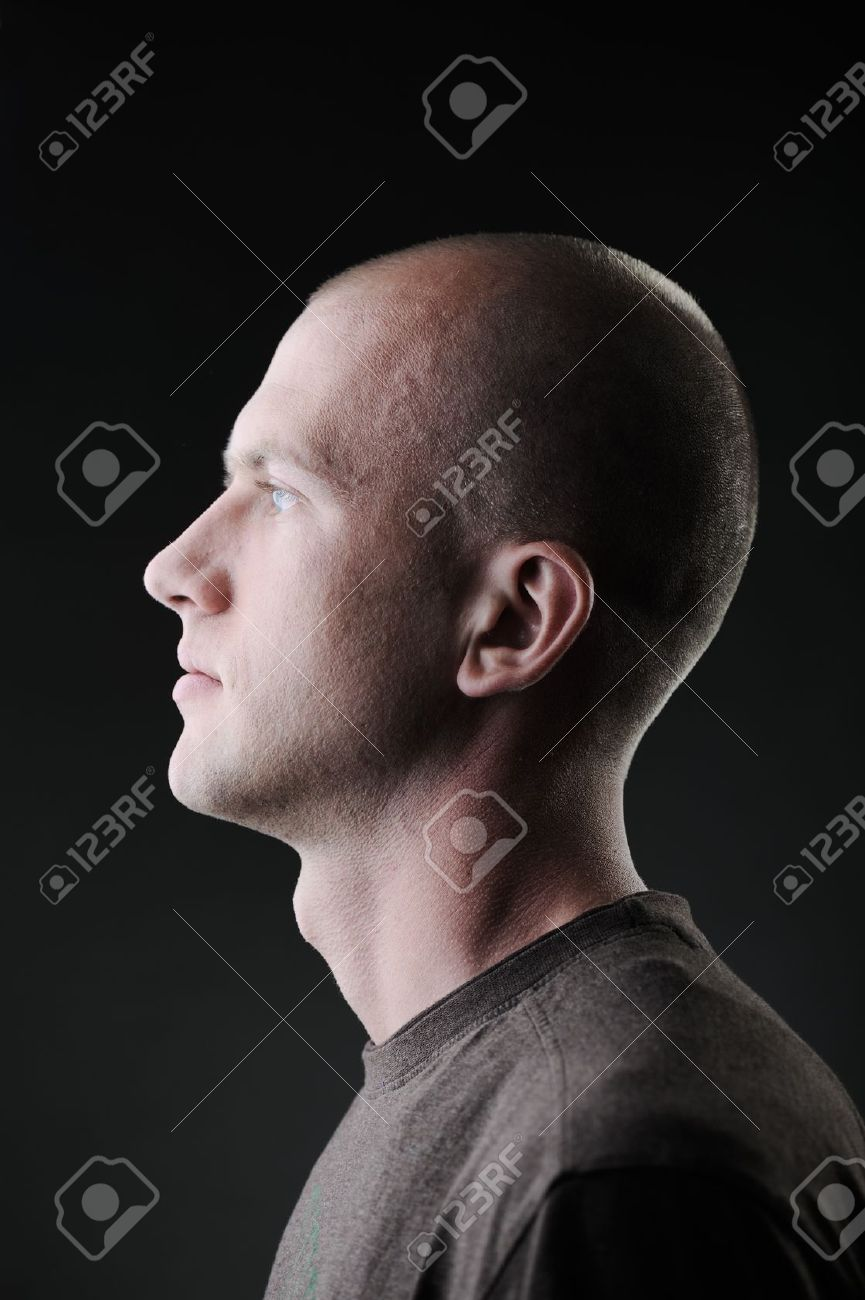 Profile of white bald man in his twenties in dark Stock Photo - 13825309