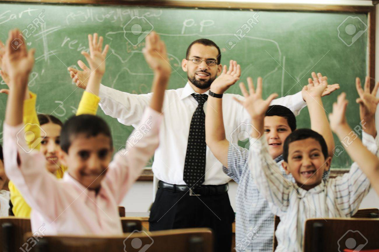 Teacher With Boys And Girls In School Stock Photo, Picture And ...
