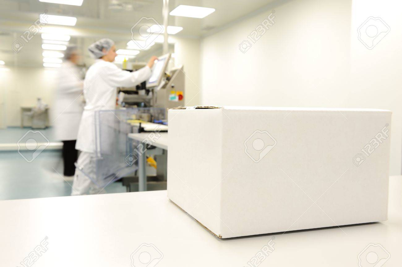Crate in front of medical staff in modern factory Stock Photo - 14054688
