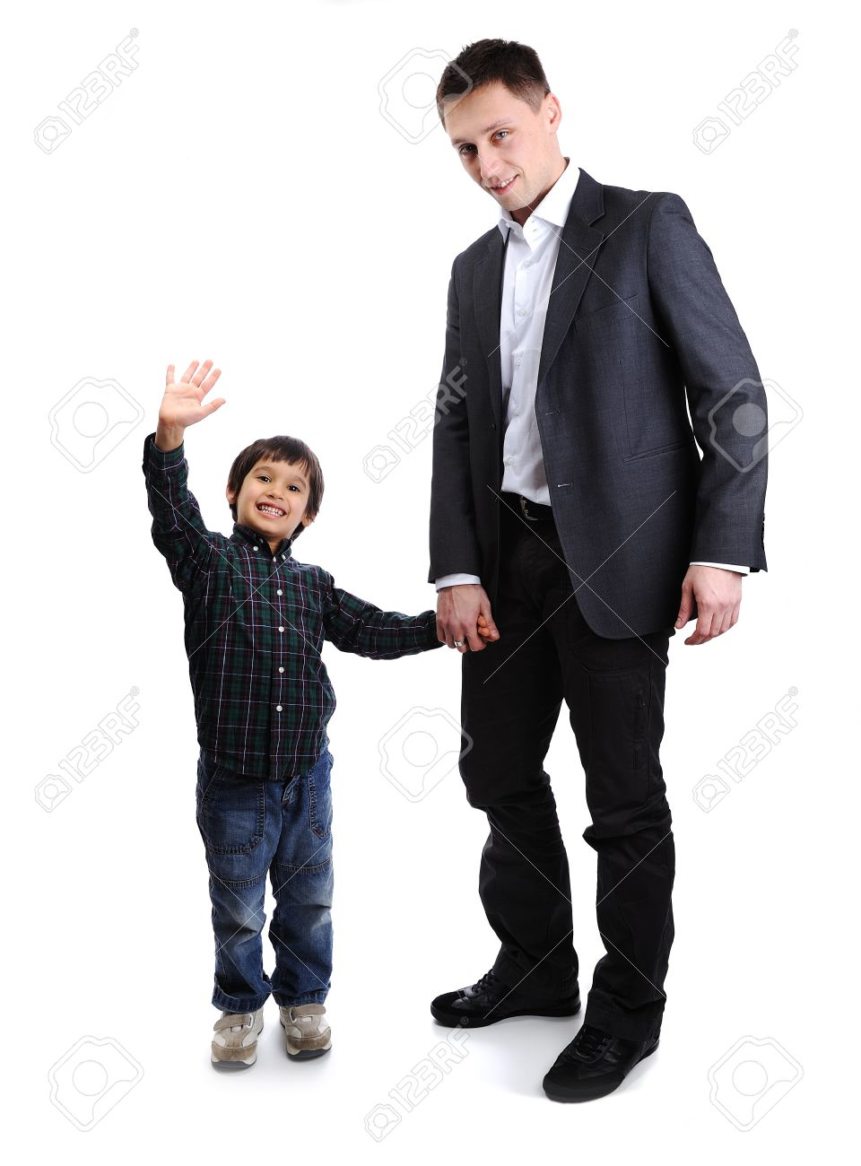 Son and father, child and adult standing, full body Stock Photo - 14580469