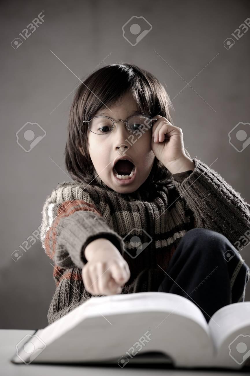 Fine portrait of cute little boy reading book Stock Photo - 19420928