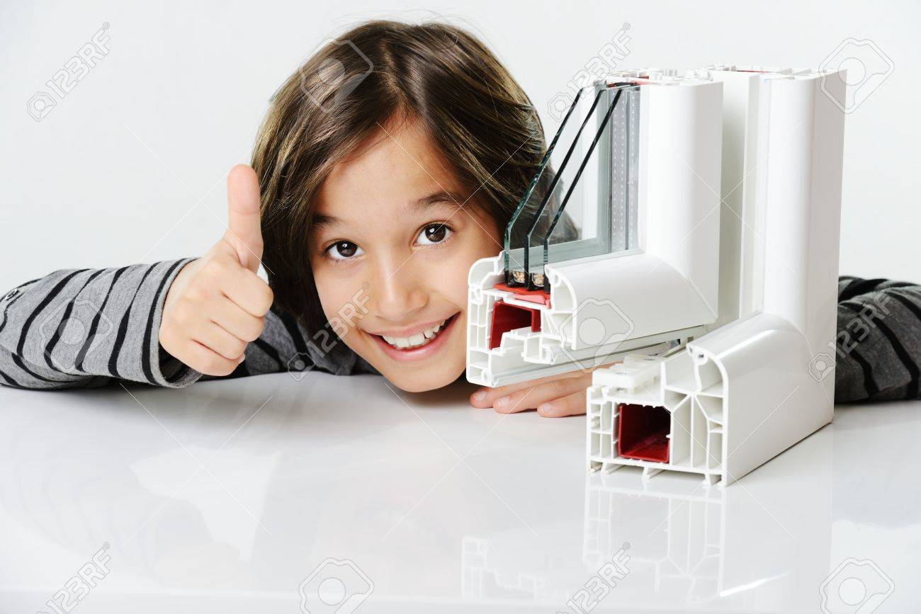 Kid holding plastic pvc window profile Stock Photo - 26353725