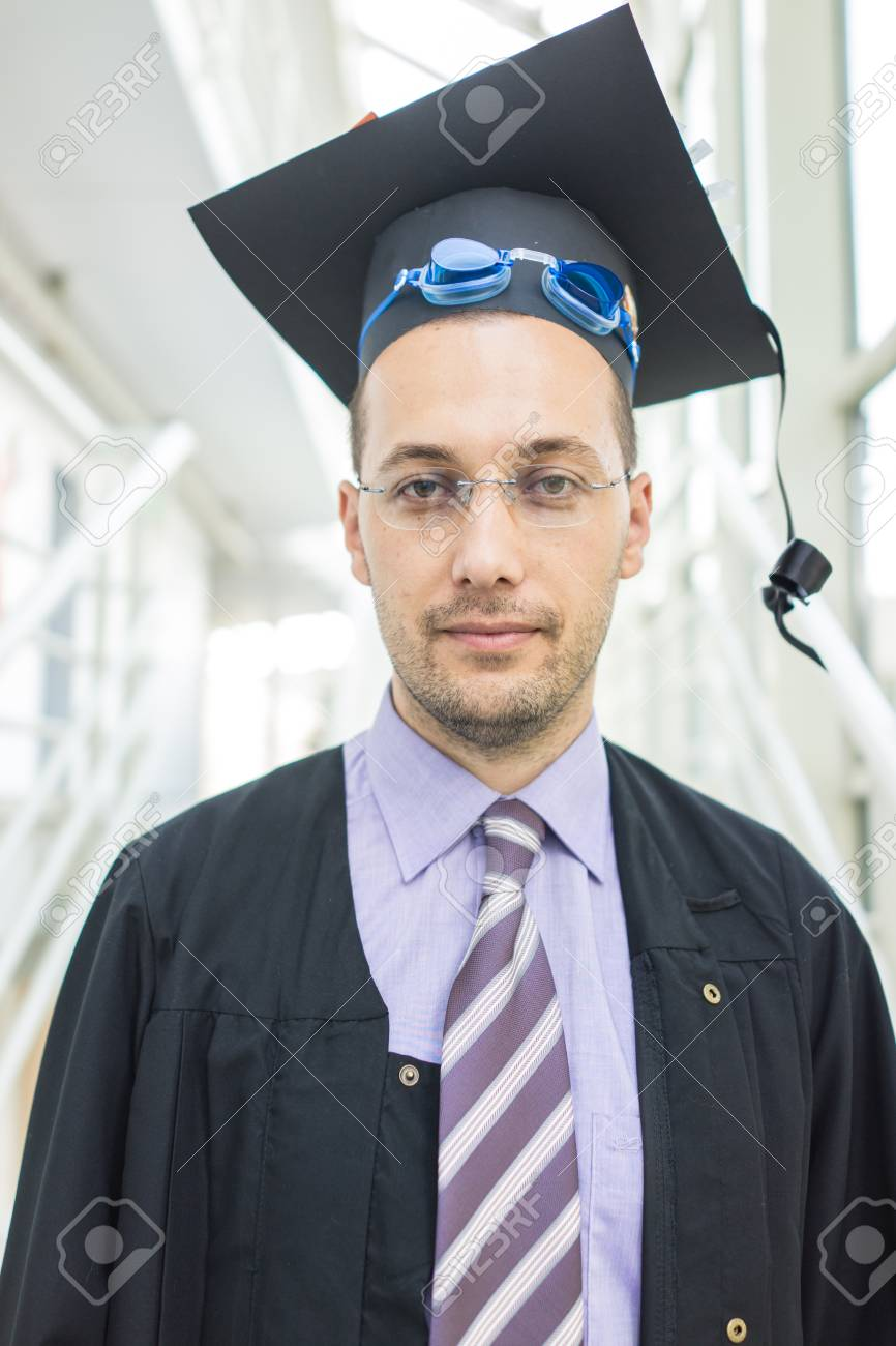 Young Male Student In Black Graduation Gown Stock Photo, Picture And ...