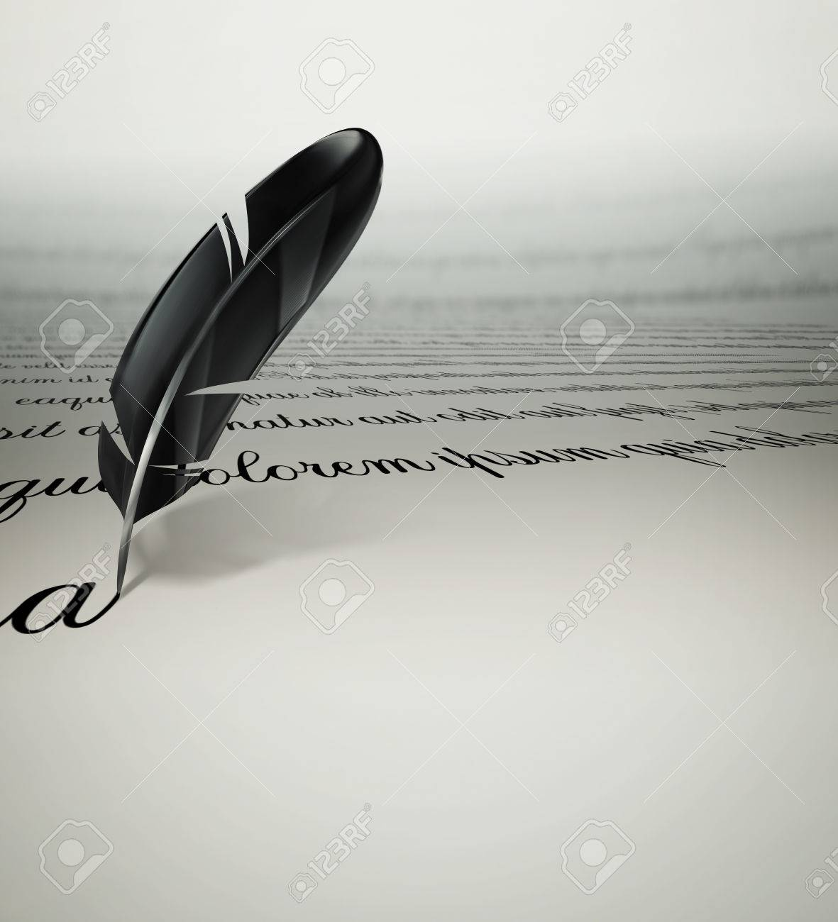 a writing text feather on paper stock photo, picture and royalty