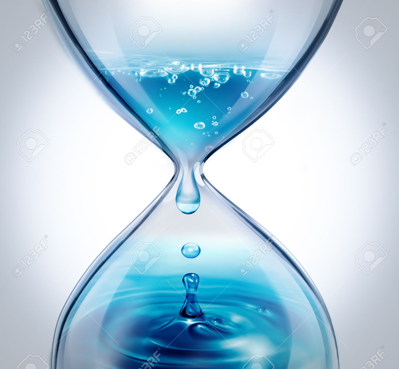 hourglass with dripping water close-up on a light background - 47320063
