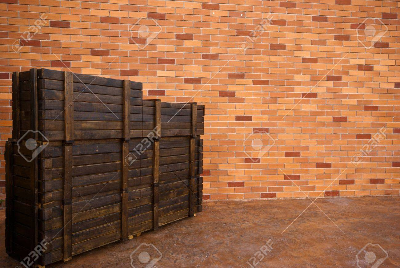 modern brick wall background with old wooden  boxes Stock Photo - 12585164