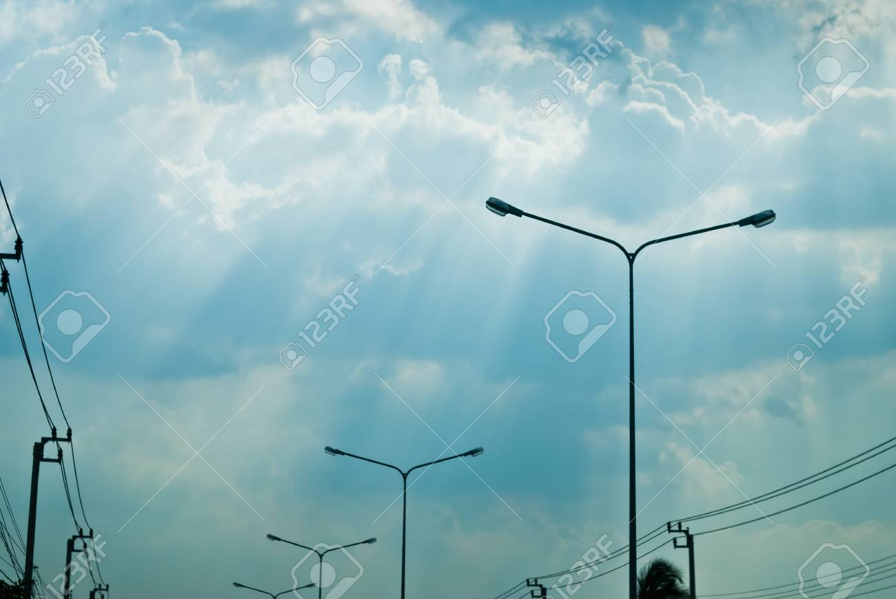 Beautiful blue sky with sun beam and electric poles Stock Photo - 13689549