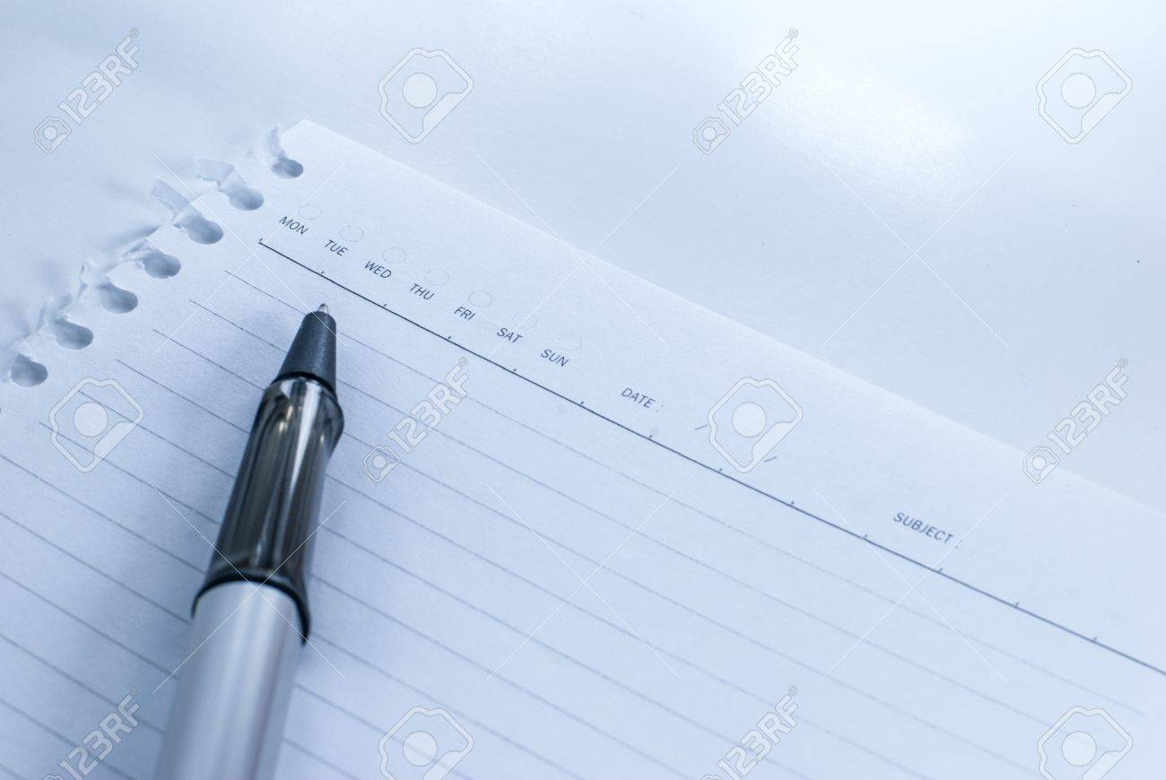 Blank notebook with date and day - White paper texture background - Ballpoint pen on checked notebook paper Stock Photo - 14369666