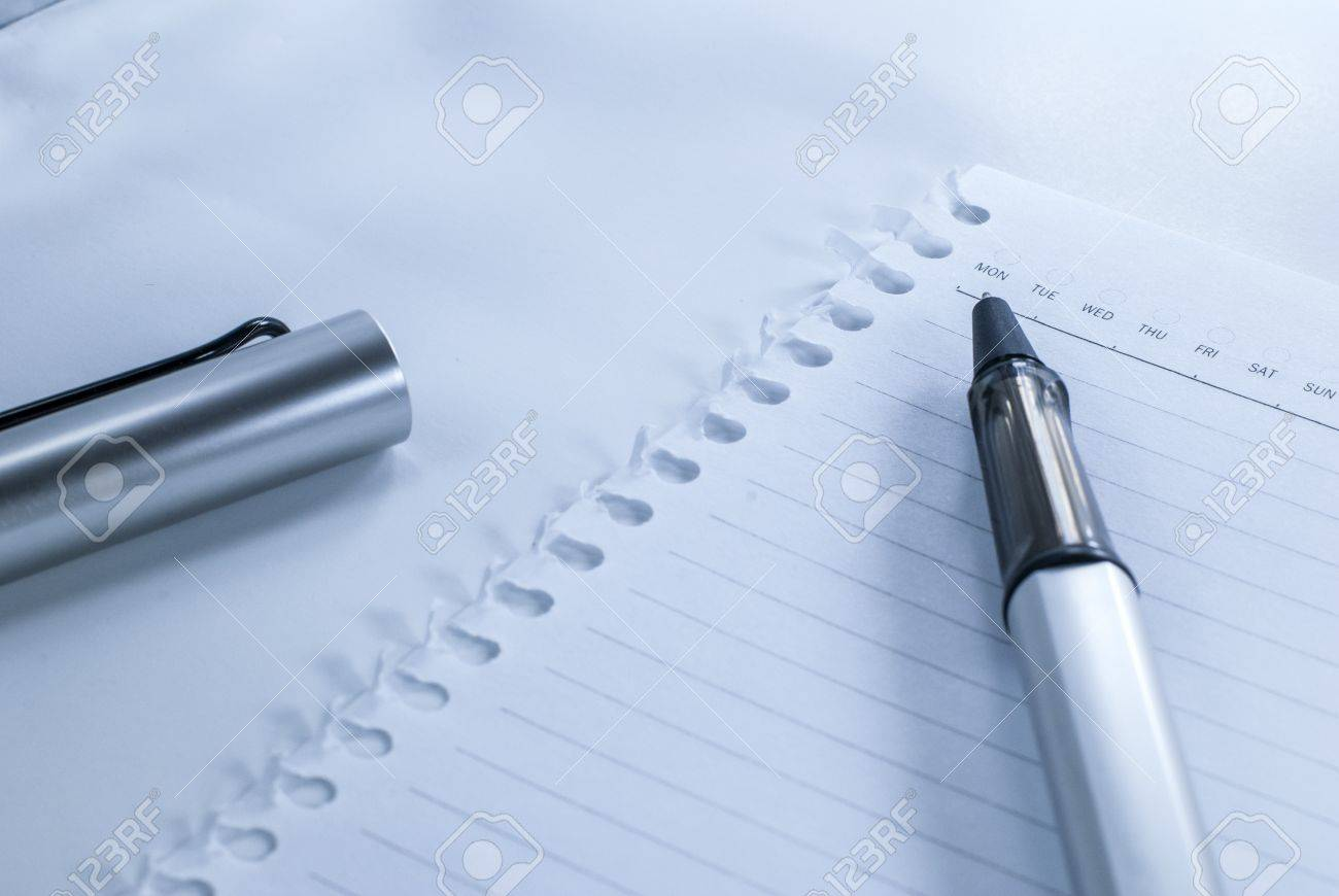 Blank notebook with date and day - White paper texture background - Ballpoint pen on checked notebook paper Stock Photo - 14369672