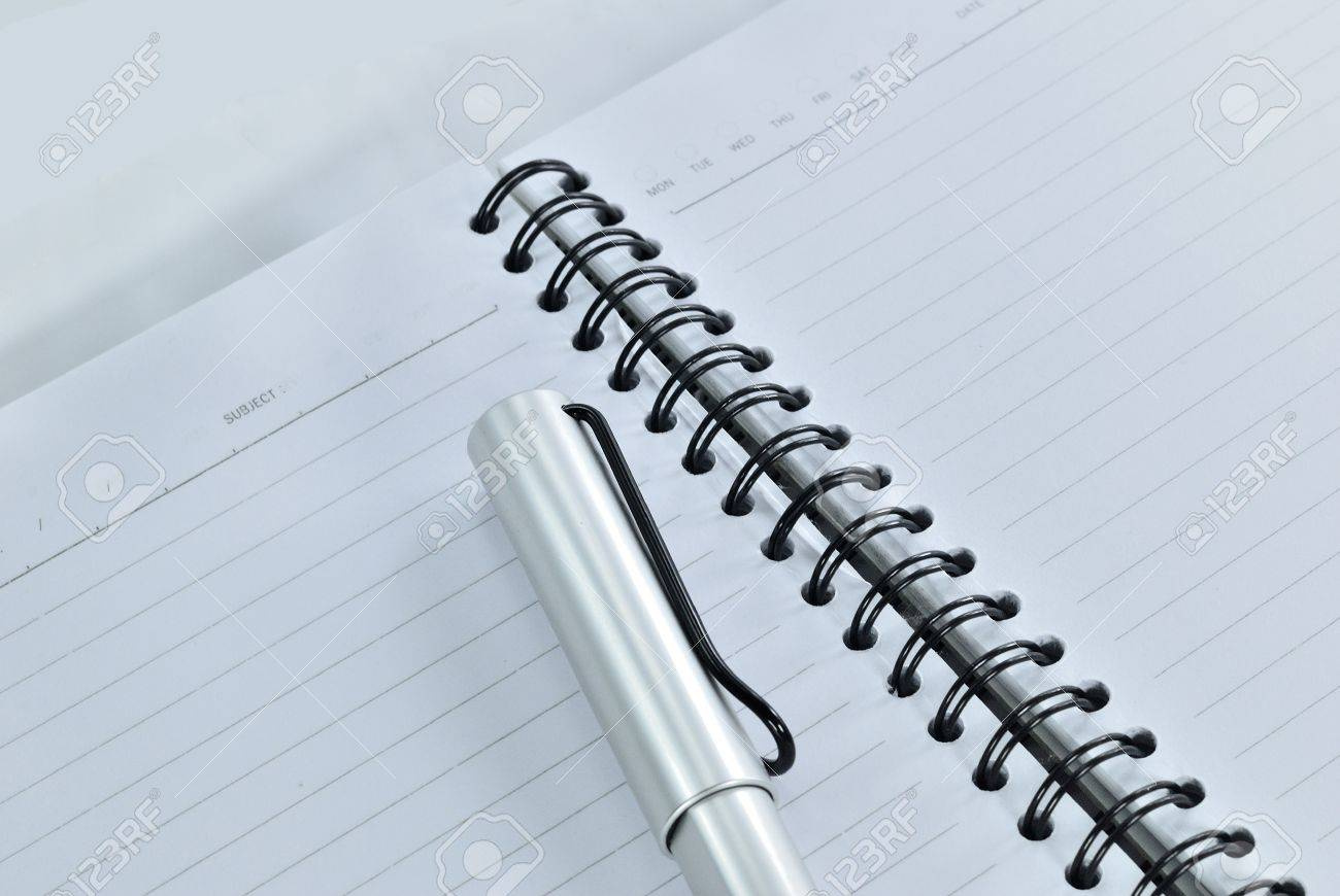 Blank notebook with date and day - White paper texture background - Ballpoint pen on checked notebook paper Stock Photo - 14369683