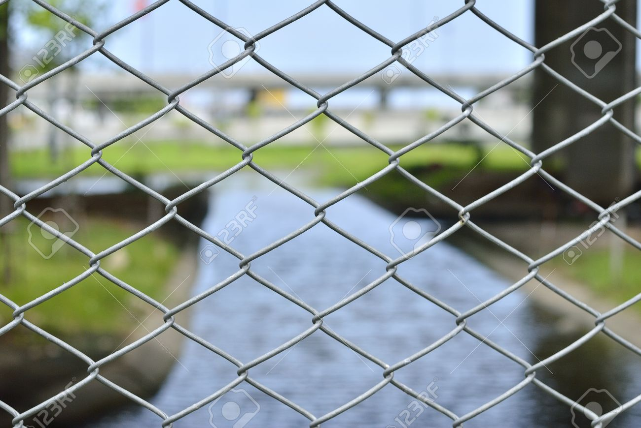 wire mesh with river background - A shiny chrome grill - chain