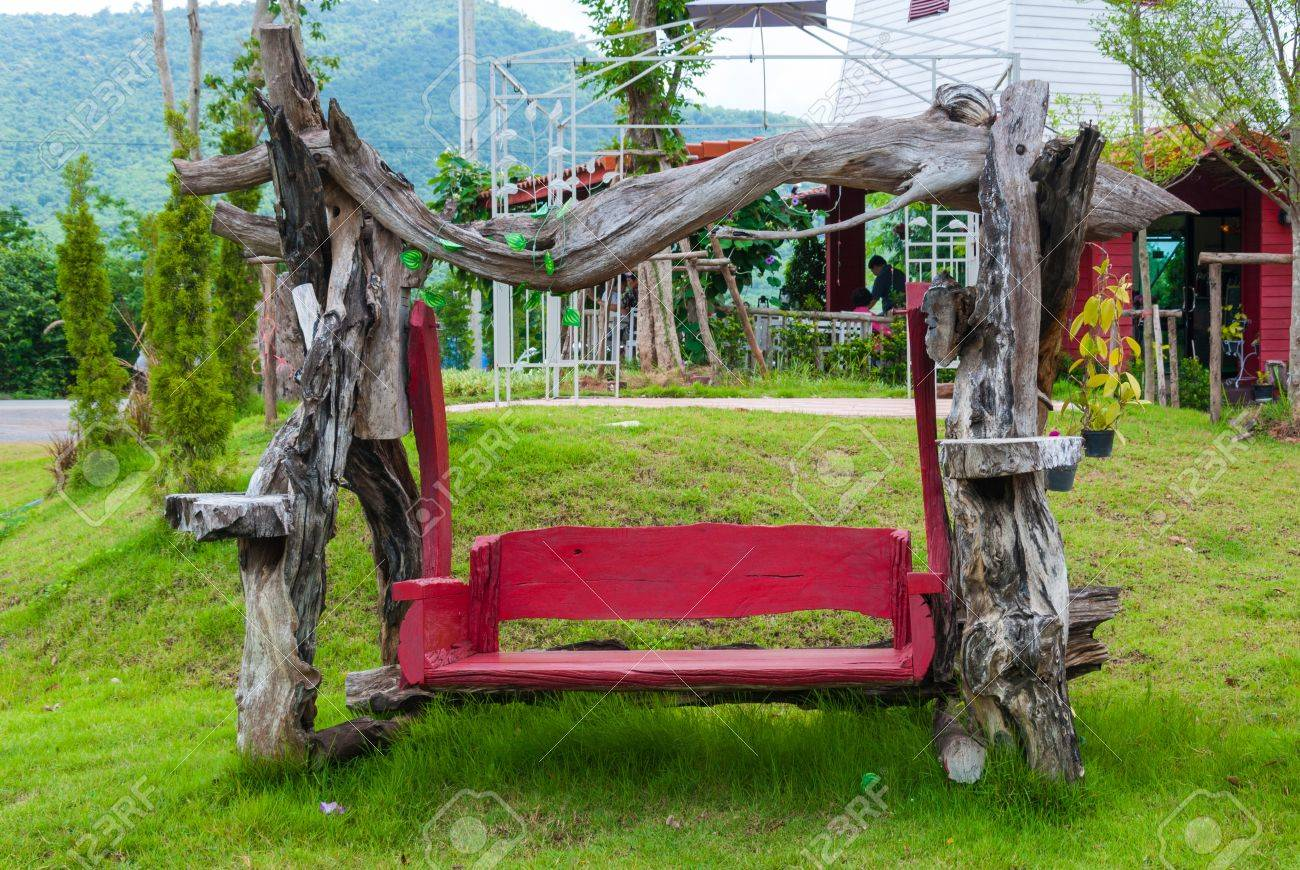 Red Empty Wooden Garden Swing Bench In The Garden Or Park Stock Photo    21566071