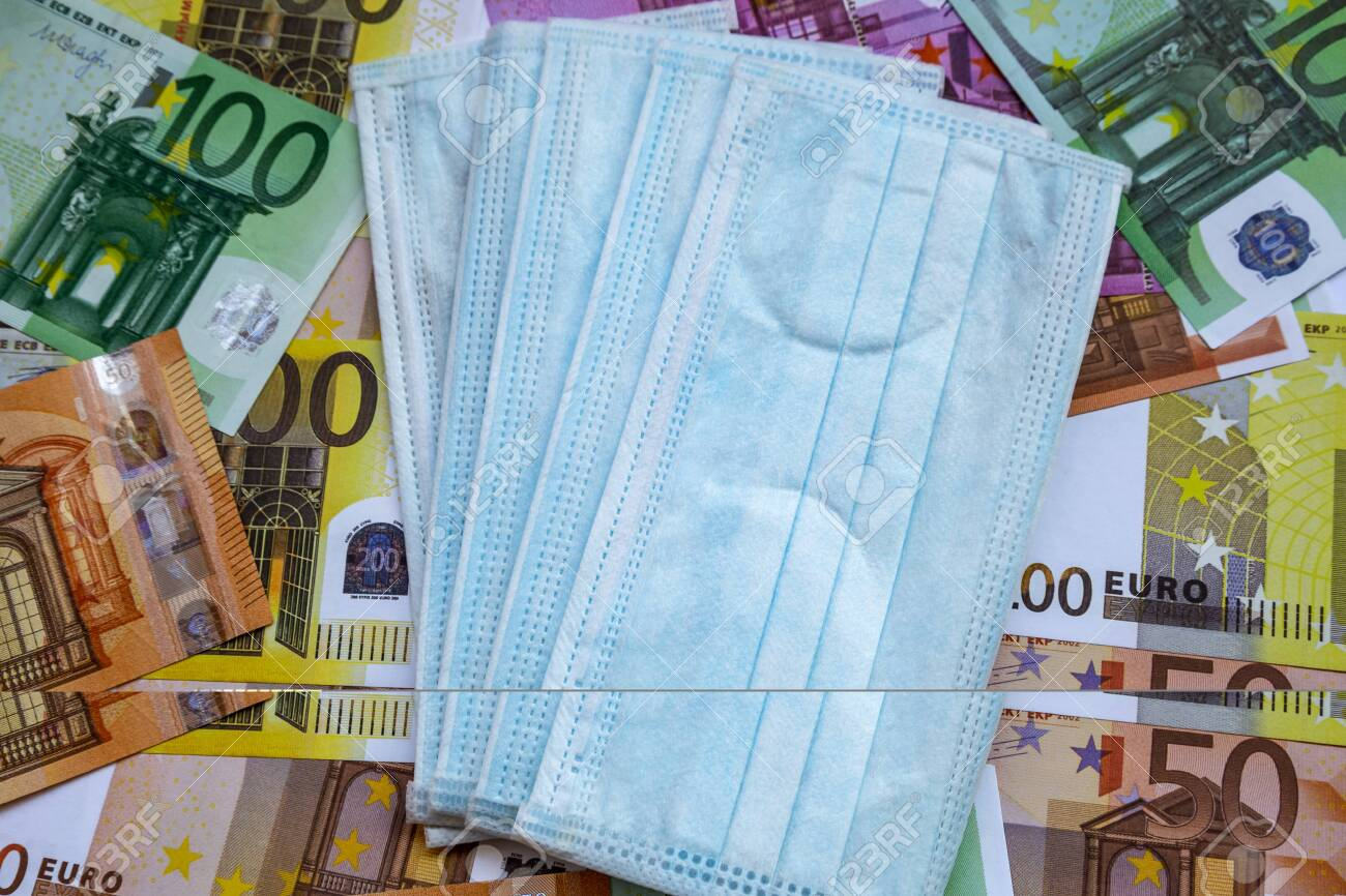 Euro Banknotes And A Protective Mask Against Coronavirus. The ...