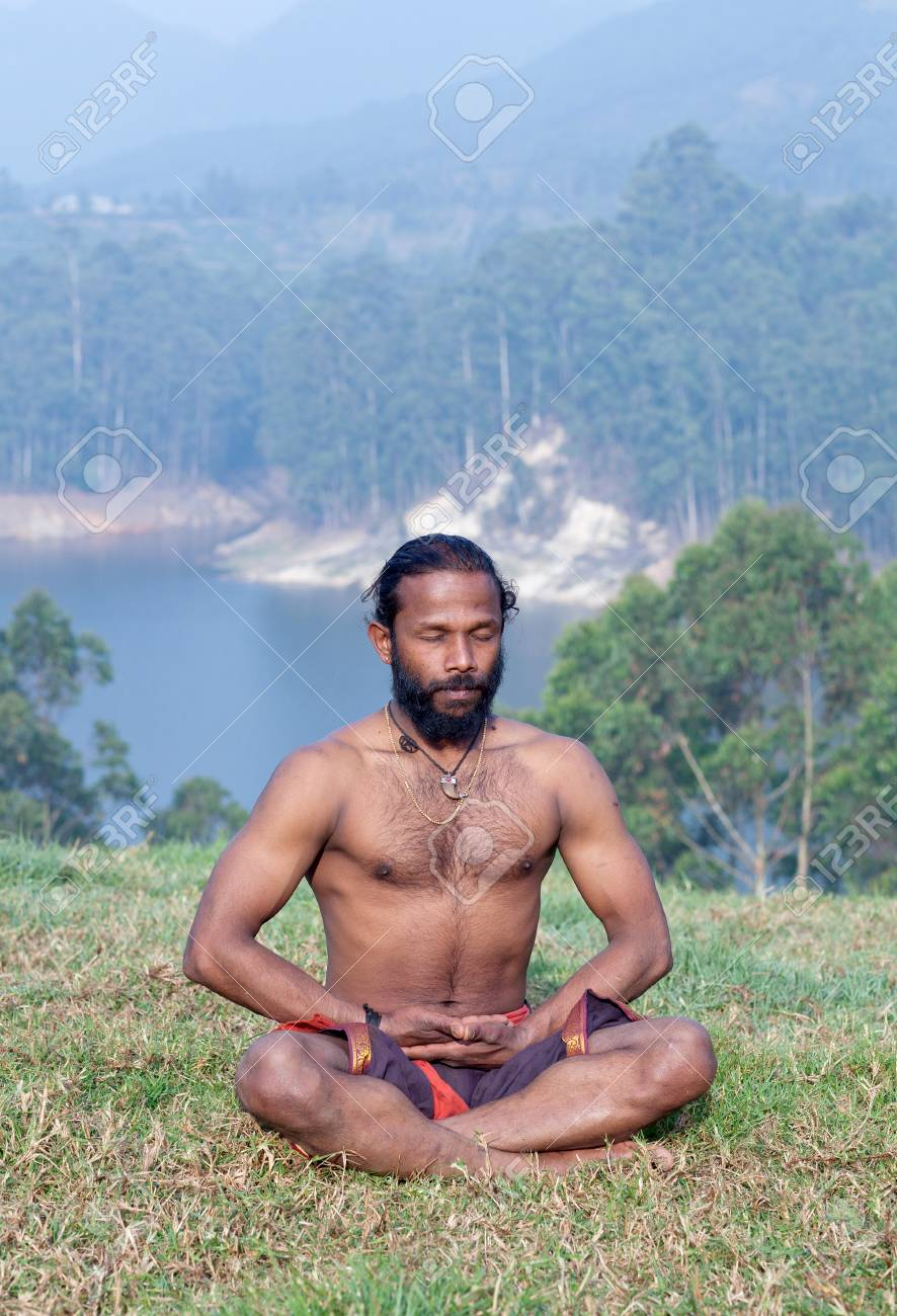 Athletic Indian Man Doing Breathing Exercises In Lotus Yoga Pose Stock Photo Picture And Royalty Free Image Image 100947249