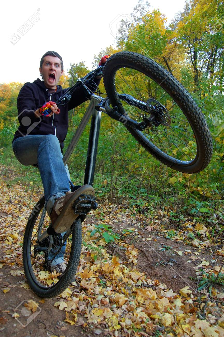 extatic young man wildly riding his bicycle Stock Photo - 2514196