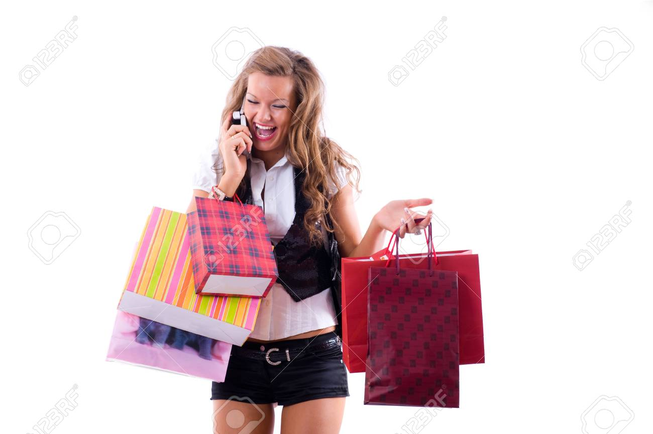 Close-up of happy young woman on a shopping spree. Talking by phone Isolated on white background Stock Photo - 3452967
