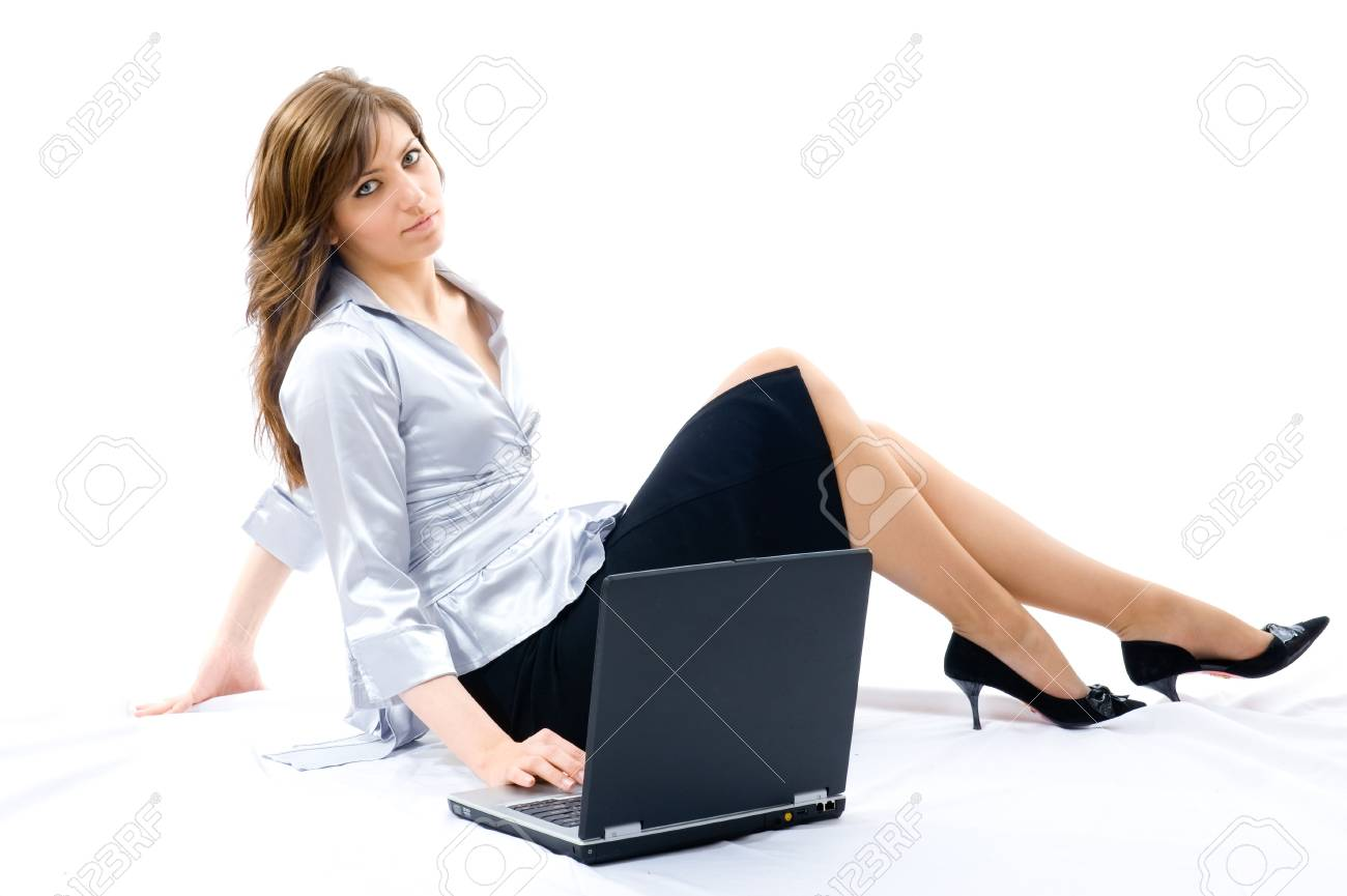 Young businesswoman working with laptop. Lying on the floor. Isolated on white background Stock Photo - 4116441