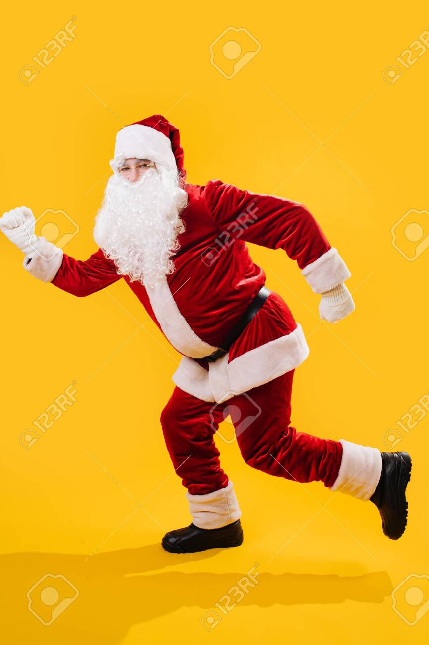 Happy Dancing Santa Claus Doing A Version Of A Modern Walking Stock Photo Picture And Royalty Free Image Image 135082393
